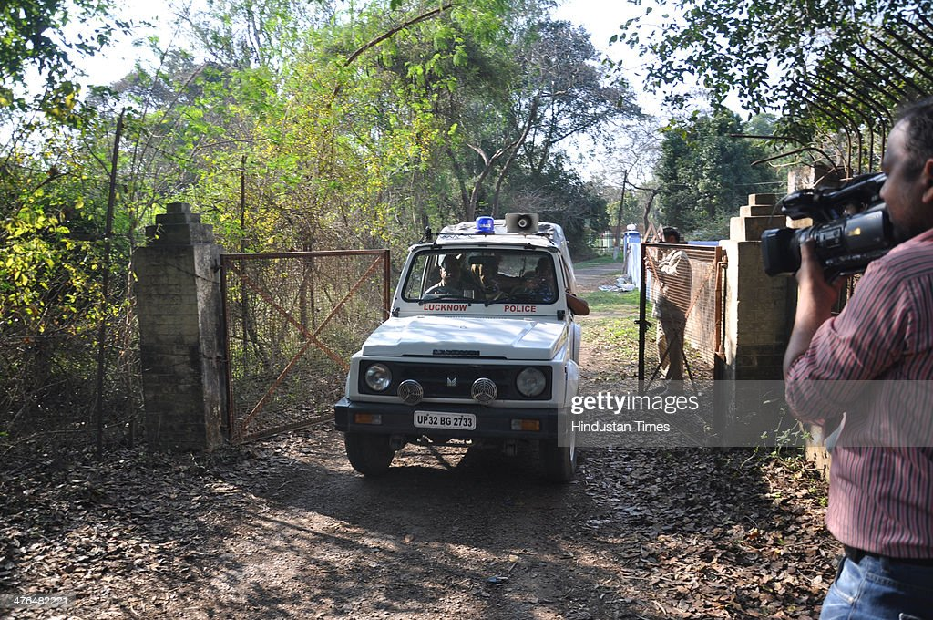 A police jeep zooming out at Kukrail guest house while Sahara India chief Subrata Roy being taken to Delhi from the back side of Kukrail campus on March 3, 2014 in Lucknow, India. Sahara Chief Subrata Roy is being brought to Delhi by Uttar Pradesh police following his arrest to be produced before the Supreme Court tomorrow.