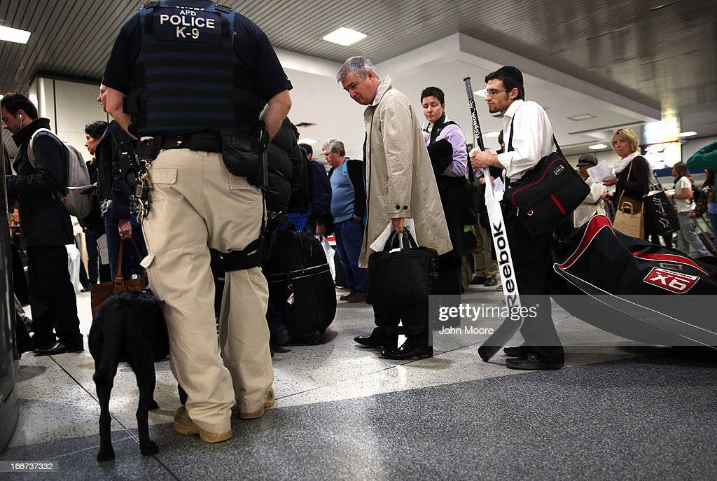 A police K-9 unit stands by as passengers line up to board an Amtrak train at Penn Station on April 16, 2013 in New York City. Police were out in force throughout New York, a day after explosions near the finish line of the Boston Marathon killed 3 people and wounded more than 170 others.