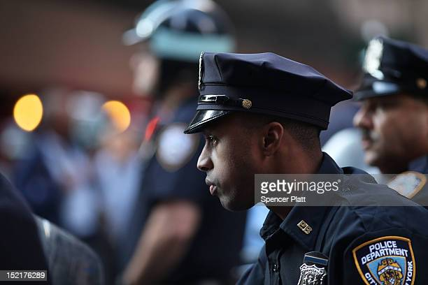 Police keep guard along Wall Street during 'Occupy Wall Street' demonstrations on September 17 2012 in New York City The 'Occupy Wall Street'...