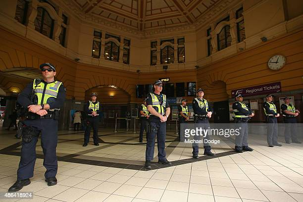 Police keep guard as Rail Tram and Bus Union State members protest at Flinders Street Station during their strike on September 4 2015 in Melbourne...