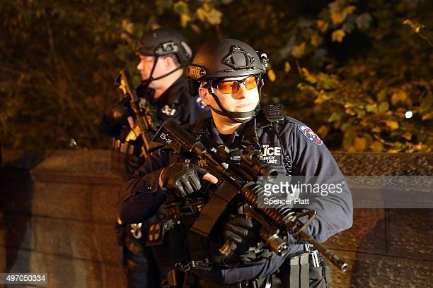 Police keep guard outside of the French consulate in Manhattan following an attack on civilians in Paris on November 13 2015 in New York City At...