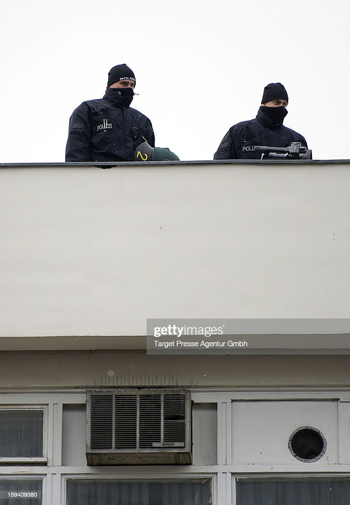 Police keep look from a rooftop as Salafites hold benefit rally for Syrian Muslims on January 13, 2013 in Berlin. Two dozen members of 'Pro Deutschland' waited in the centre of Berlin for Salafites who originally planned to hold a public gathering to raise money for Muslims in Syria, which included prominent speakers such as radical Islamic preacher Pierre Vogel. They then moved the event to a private gathering in Neukoelln district. Salafites are an ultra-conservative group of Muslim sunnis with hundreds of members in Berlin and the area around Bonn and cologne. German authorities are keeping a close eye on the group, espacially since clashes that broke out last year in which Salafite demonstrators attacked police and right-wing counter-demonstrators. on January 13, 2013 in Berlin, Germany.
