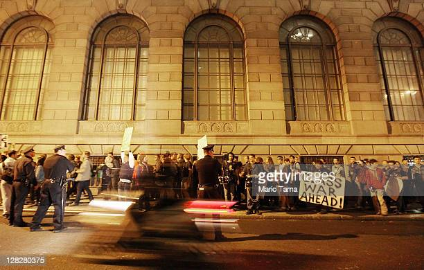 Police keep watch as protesters affiliated with the Occupy Wall Street movement though Lower Manhattan's Financial District on October 5 2011 in New...
