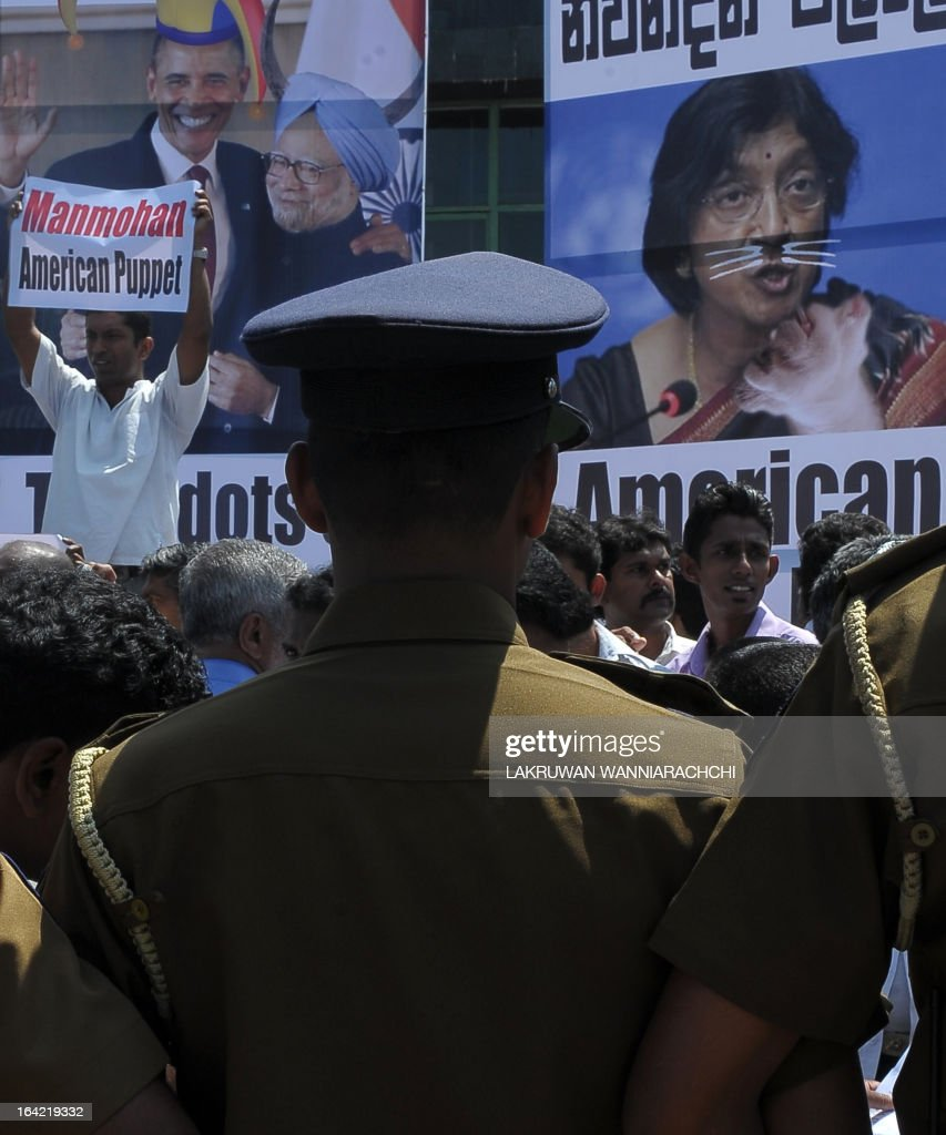 Police keep watch as Sri Lankan pro-government activists protest outside the US embassy in Colombo on March 21, 2013, as the UN Human Rights Council in Geneva was set to vote on a resolution pressing for a war crimes probe against Sri Lanka. Hundreds of demonstrators held up traffic outside the US embassy, close to Sri Lankan President Mahinda Rajapakse's official residence, and chanted slogans denouncing US President Barack Obama and India's Prime Minister Manmohan Singh.