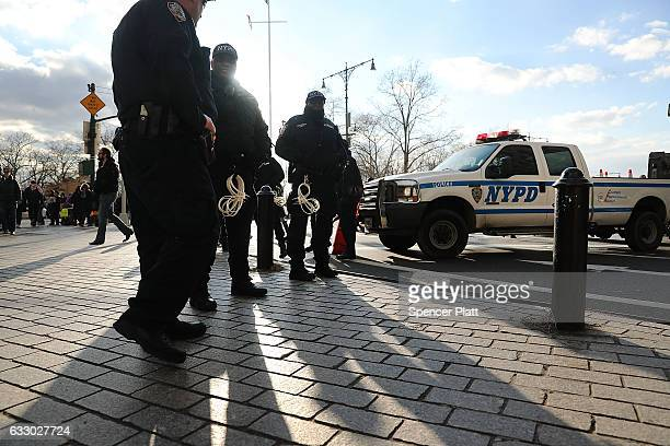 Police keep watch as thousands attend an afternoon rally in lower Manhattan to protest President Donald Trump's new immigration policies on January...