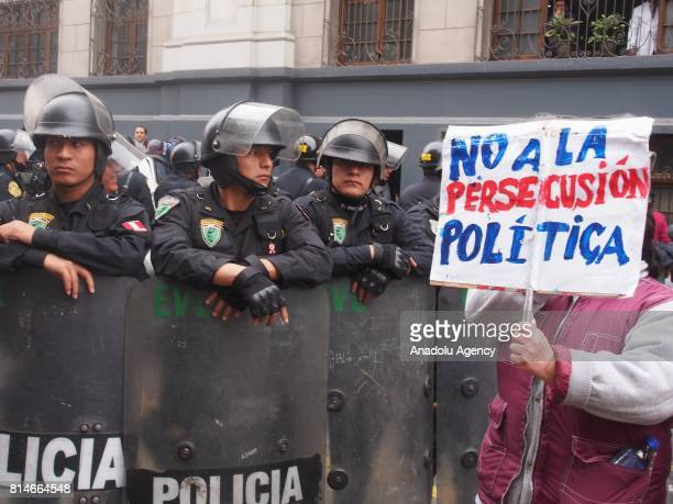 Police keeps a security perimeter during the transportation of former Peruvian President Ollanta Humala while and his wife Nadine Heredia toward the...
