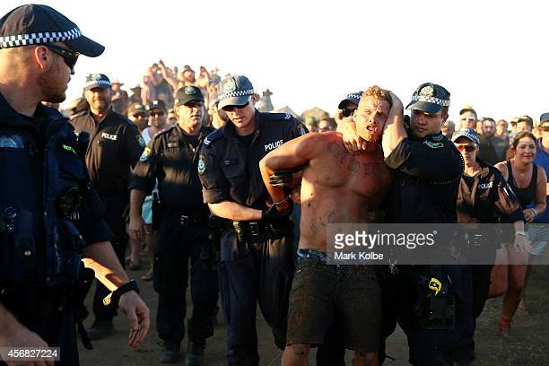 Police lead away a man after an altercation in the 'Ute Paddock' camp ground on the second day of the 2014 Deni Ute Muster at the Play on the Plains...