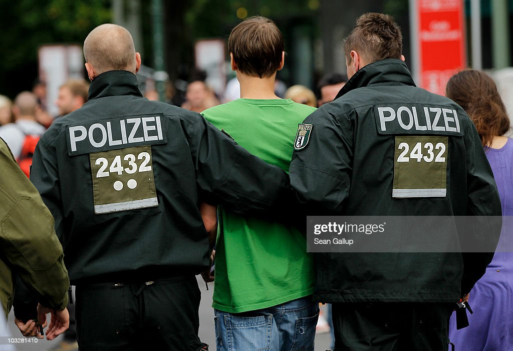Police lead away a young man during the annual Hemp Parade, or 'Hanfparade', which is a march in support of the legalization of marijuana in Germany, on August 7, 2010 in Berlin, Germany. The consumption of cannabis in Germany is legal, though all other aspects, including growing, importing and selling it, are not. However, since the introduction of a new law in 2009, the sale and possession of marijuana for licenced medicinal use is legal.