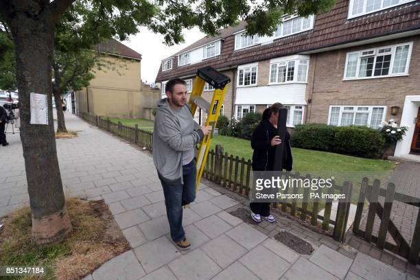 Police leave the flats in Bray Court in Chessington Surrey where they arrested the brother of the British engineer Saad alHilli who was shot dead...
