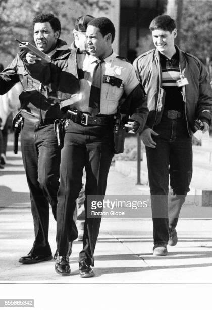 Police leave the headquarters building in Houston on Dec 6 1983