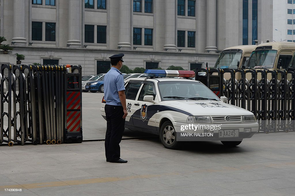 Police leave the Intermediate People's Court where Chinese politician Bo Xilai where Chinese politician Bo Xilai was indicted and his case is expected to be heard in Jinan, Shandong Province on July 25, 2013. China's once high-flying communist politician Bo Xilai was indicted on July 25 for bribery and abuse of power, state media said, following a scandal that exposed deep divisions at the highest levels of government. AFP PHOTO / Mark RALSTON