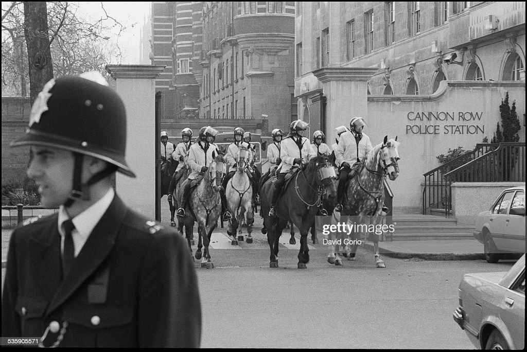Police leaving Cannon Row Police Station to take up positions for the Poll Tax March in London, UK, 31st March 1990.