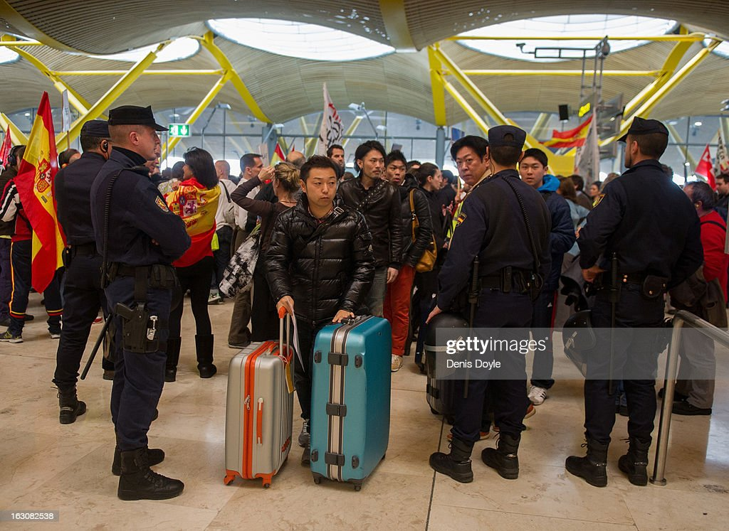 Police let passengers through to the check-in area of Barajas airport during a strike by Iberia Airlines workers on March 4, 2013 in Madrid, Spain. Iberia workers have begun the second round of five day strikes in protest at plans by holding company IAG (International Consolidated Airlines Group), formed by the 2011 merger of Iberia and British Airways, to implement redundancies and pay cuts across the troubled Spanish airline. The strike is estimated to cause the canceling of almost 1,300 flights this week, with a final round of five day strikes planned for March 18 to 22.