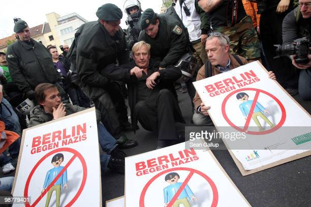 Police lift away Guenter Piening politician in the Berlin Senate at a sitin blockade where protesters tried to stop neoNazis from marching on May 1...