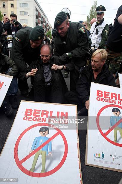 Police lift away protesters at a sitin blockade who were trying to stop neoNazis from marching on May 1 2010 in Berlin Germany Several hundred...