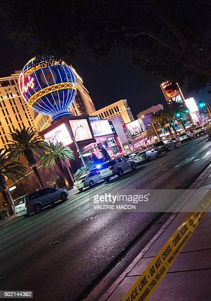 A police line blocks off part of the Las Vegas Strip after a car ran into a group of pedestrians between Planet Hollywood where the Miss Universe...