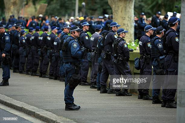 A police line holds back the crowd during a 'Stop Bush Make Howard History Rally' held at Sydney Town Hall September 8 2007 in Sydney Australia The...