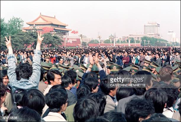 A police line is squeezed by a crowd of studentled demonstrators at Tiananmen Square 27 April 1989 in Beijing