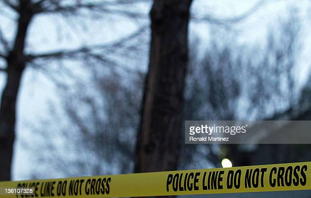 Police line tape surrounds an apartment building where seven people were found dead at Lincoln Vineyard Apartment Homes on December 25 2011 in...