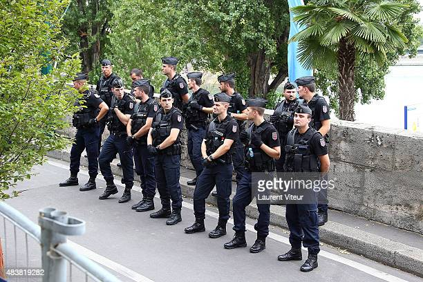 Police line up during the 'TelAviv Sur Seine' beach attractionas part of the 14th Edition of Paris Plages on August 13 2015 in Paris France Every...