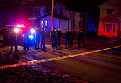 Police line up in front of a crime scene after 5 people were shot at a Black Lives Matters protest November 24 2015 in Minneapolis Minnesota...
