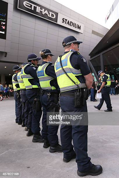 Police line up outside before the round three ALeague match between the Melbourne Victory and Melbourne City at Etihad Stadium on October 25 2014 in...