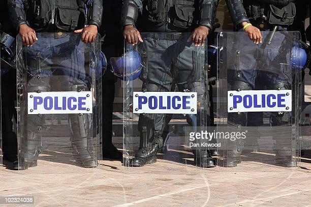 Police line up outside the Nelson Mandela Bay Stadium on June 23 2010 in Port Elizabeth South Africa England play Slovenia at the Nelson Mandela Bay...