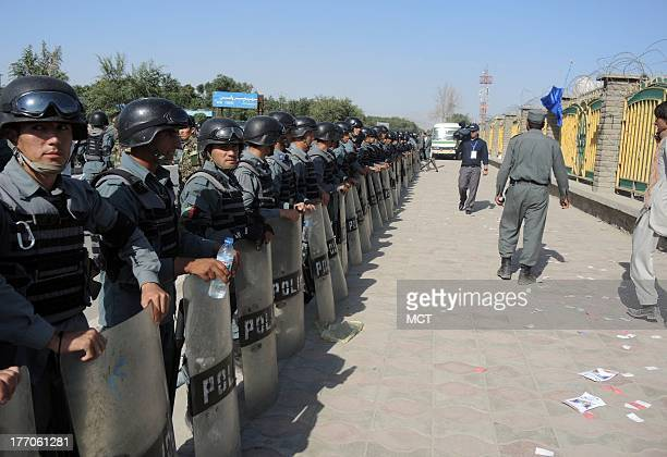 Police line up to control the crowds entering Afghanistan Football Federation Stadium for the Afghanistan national team's first home soccer match...
