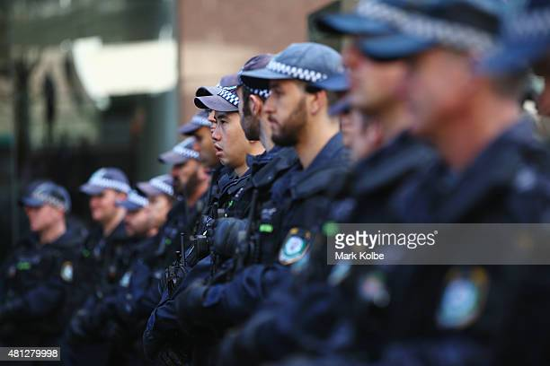 A police line watch on as they observe the protest against 'reclaim australia' rally organised to counter the 'Reclaim Australia' rally in Martin...