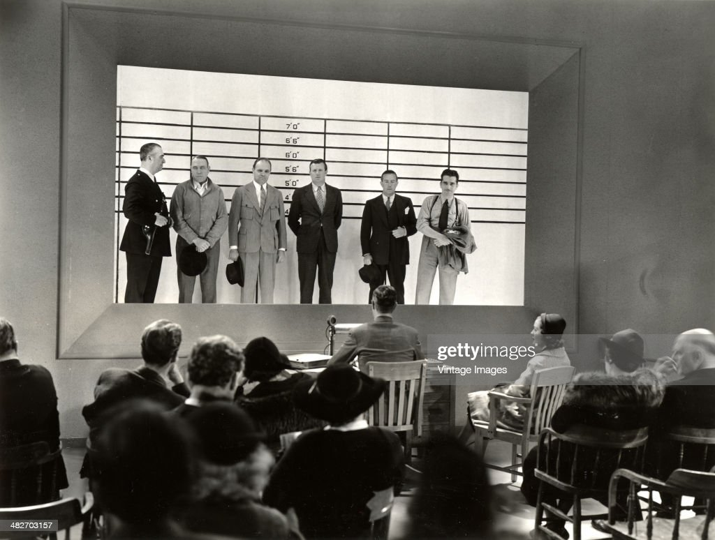 A police lineup in a scene from a movie circa 1948 Photo by stills photographer Ollie Sigurdson