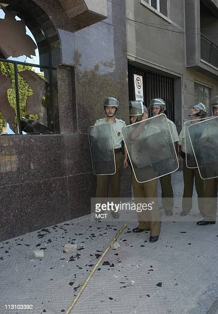 SANTIAGO CHILE Police look at damage to the Hotel Principado de Asturias after marchers looted as world leaders gathered for the annual AsiaPacific...