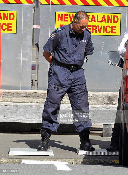 Police look into a storm water drain where a body was found in a car park next to Te Papa Museum of New Zealand on January 15 2012 in Wellington New...