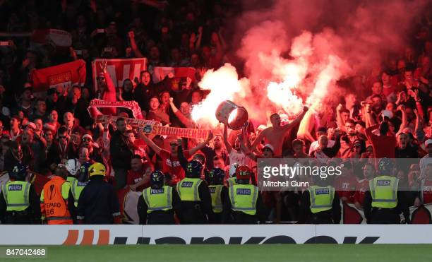 Police look on as Cologne fans ignite flares and celebrate a goal during the UEFA Champions League group C match between Chelsea FC and Qarabag FK at...