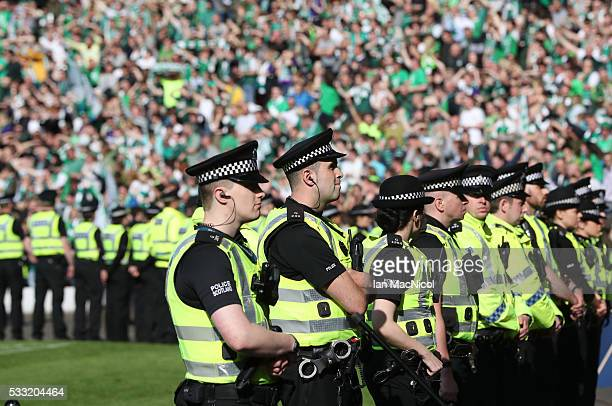 Police look on as Hibs fans celebrate during the Scottish Cup Final between Rangers and Hibernian at Hampden Park on May 21 2016 in Glasgow Scotland