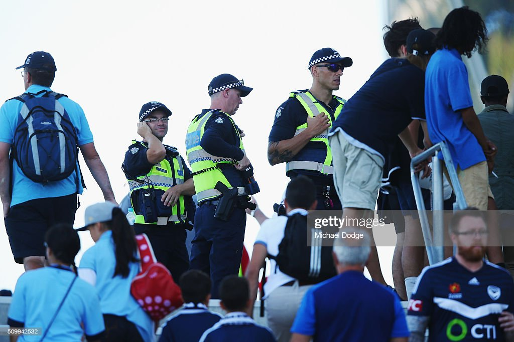 Police look on as Melbourne Victory fans arrive down City Rd for the round 19 A-League match between Melbourne City FC and Melbourne Victory at AAMI Park on February 13, 2016 in Melbourne, Australia.