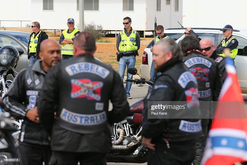 Police look on as members of the Rebels motorcycle club regroup at the Tammin roadhouse onroute to Perth on September 12, 2013 in Perth, Australia. An estimated 1000 Rebels from chapters all over Australia gather for the road trip across the country to Perth.