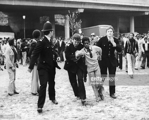 Police make an arrest during serious riots at the Notting Hill Carnival London 31st August 1976