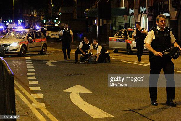 Police make an arrest while patroling the streets in Ealing on August 8 2011 in London England Sporadic looting and clashes with police continue for...