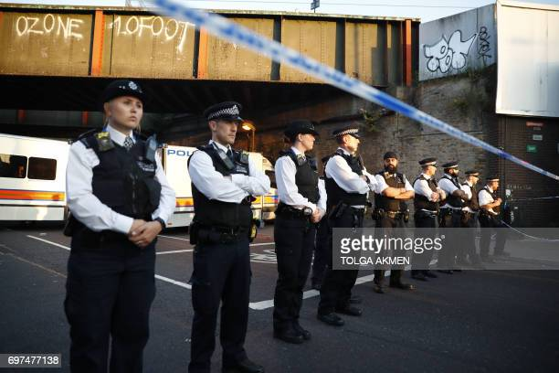 Police man a cordon at the scene in the Finsbury Park area of north London after a vehichle hit pedestrians on June 19 2017 One man was killed and...