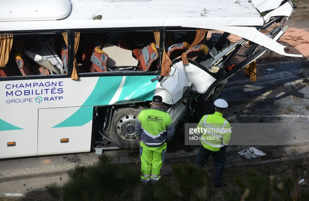 A police man and a technician arrive at the site of an accidented French bus near Rokycany, Czech Republic, on April 08, 2013. 41 passengers were injured, a young woman died in the accident of a French bus on its way to Prague.