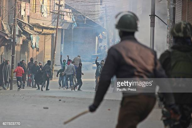 Police man chancing protesters during clashes Soon after Friday prayers people in large number assembled at Jamia Masjid area of Sopore town some 55...