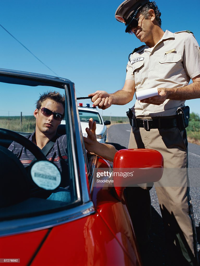 Police man checking driving identification : Stock Photo