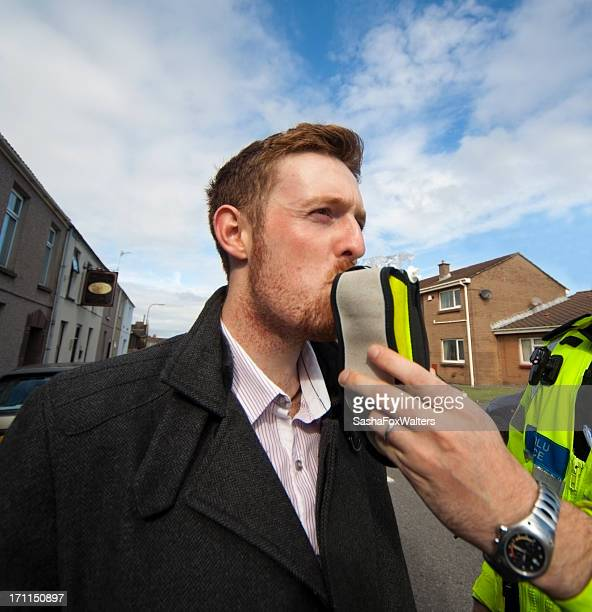 A police man giving a man an alcohol test