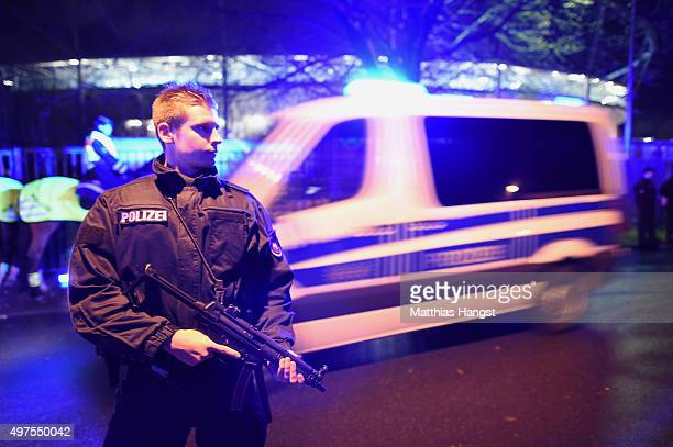 A police man protects the evacuated HDI Arena prior to the International Friendly match between Germany and Netherlands at HDI Arena on November 17...