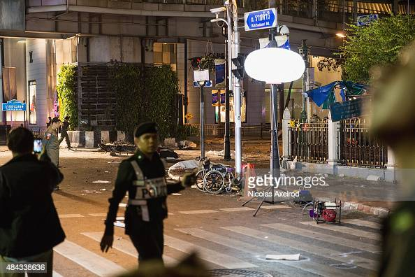 A police man walks past the scene of an explosion on August 17 2015 in Bangkok Thailand A large explosion believed to a bomb has hit central Bangkok...