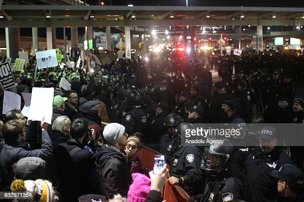 Police members intervene and arrest some of activists during the protest against President Donald Trump's 90days ban of entry on 7 Muslimmajority...