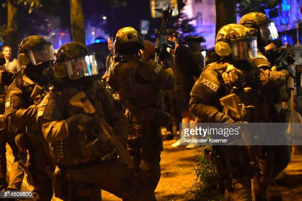 Police Members of a German SWAT from Bavaria hold a HK416 A5 machine gun towards an observed apartment complex used by protesters from the leftwing...