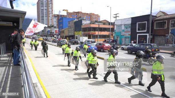 Police members take security measures as students attend the march against the privatization of public universities in Bogota Colombia on October 04...