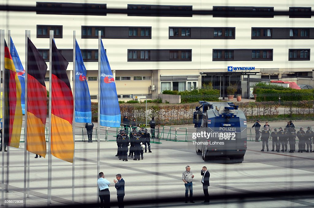 Police men and a water cannon protect the Alternative fuer Deutschland (AfD) party's federal congress at the Congress Centre (ICS) on April 30, 2016 in Stuttgart, Germany. The AfD, a relative newcomer to the German political landscape, has emerged from Euro-sceptic conservatism towards a more right-wing leaning appeal based in large part on opposition to Germany's generous refugees and migrants policy. Since winning seats in March elections in three German state parliaments the party has sharpened its tone, calling for a ban on minarets and claiming that Islam does not belong in Germany.
