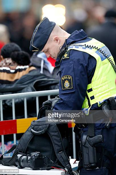 A police men checks a bag of a spectator prior the arrival of Pope Francis at Kungshuset on October 31 2016 in Lund Sweden The Pope is on 2 days...